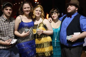 Giggling gals with glittery gams go gambling with gregarious gangsters for the 35th Annual Casino Night