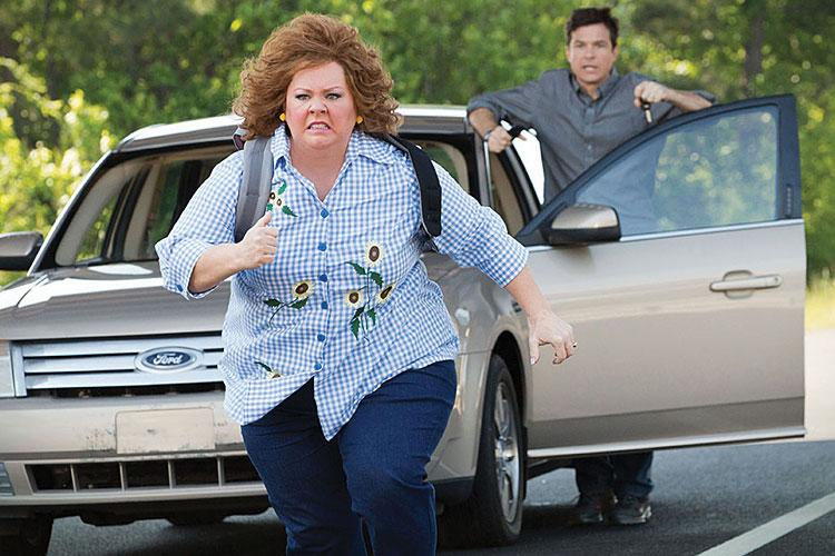 Melissa McCarthy may not be able to escape this movie, but that doesn't mean you can't. Jason Bateman's in the back, cheering on the idea of escape.