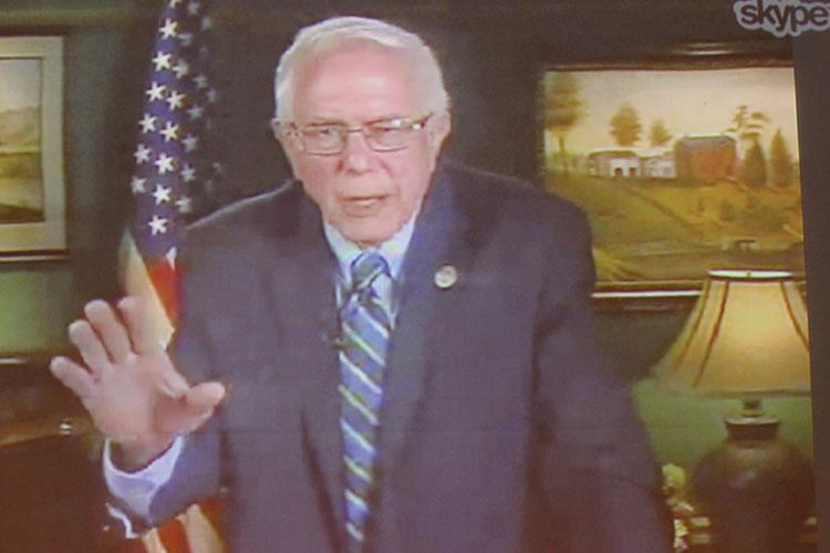 Senator Bernie Sanders addressing audience in Bentley via Skype
