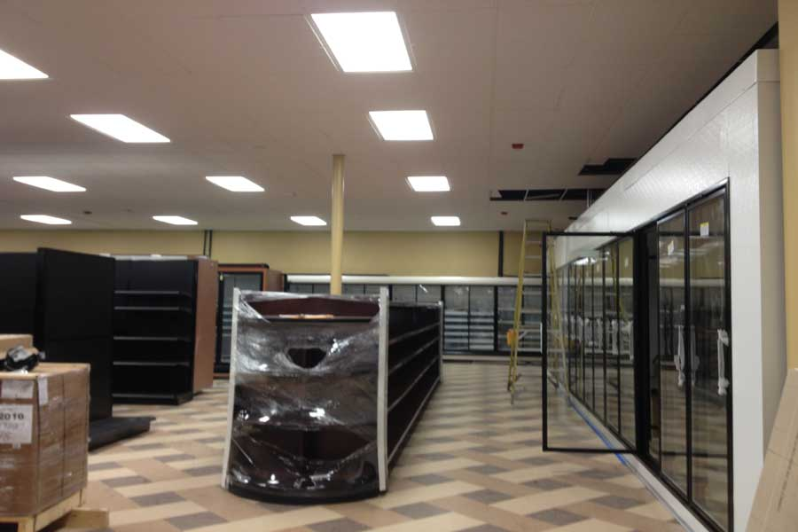 Shelves and freezers await stocking in Johnsons Sterling Market. The old Grand Union space has been gutted and rebuilt.