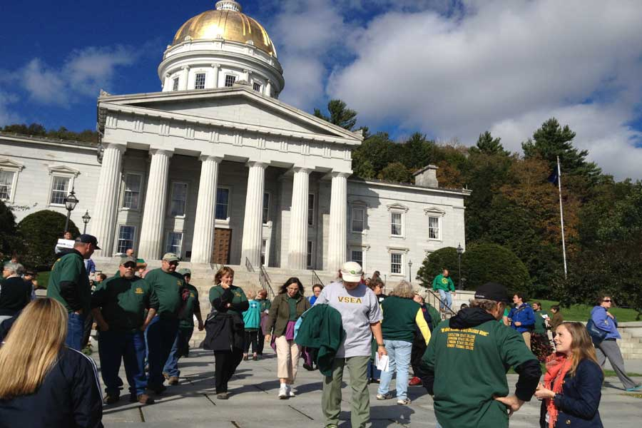 Vermont State Employee Association union members gather at the State House