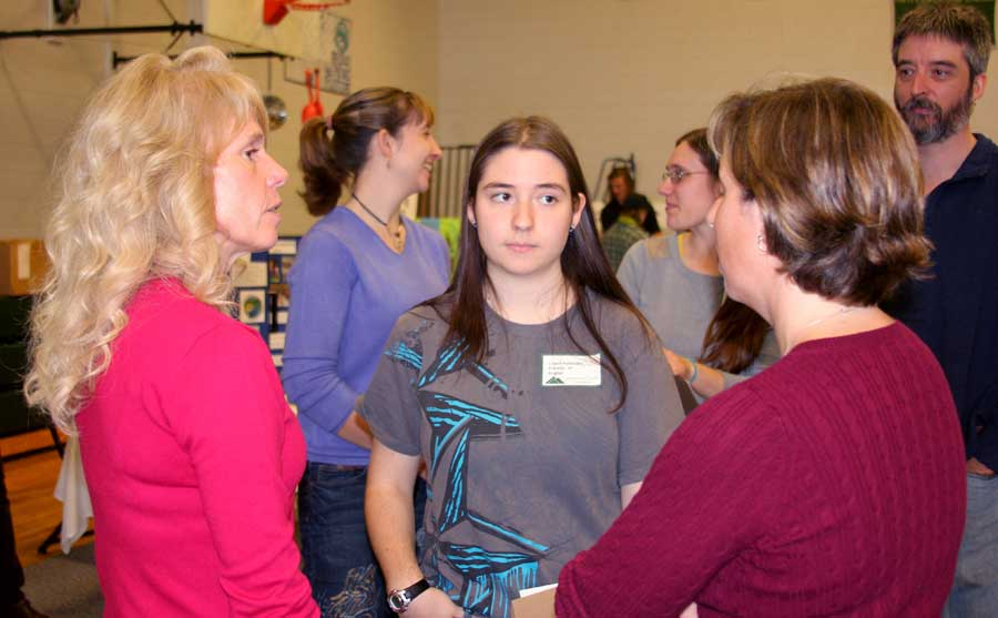 Assistant Director of Admissions Joye Lyon talks with prospective students and parents at JSC's open house Oct. 19 (photo by Victoria Greenia)