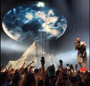 Kanye West on stage during one performance in his Yeezus Tour