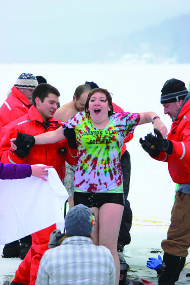 JSC student Amanda Rae Bolduc catches her breath as Johnson Water Rescue helps her out of the icy water