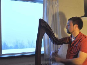 Jeff Ketcham relaxes with his harp
