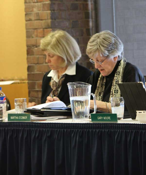 Chair of the Finance and Facilities Committee Martha O'Conner delivers the resolution to review and approve the 2014-2015 academic year tuition and fees at the VSC board of trustees meeting on Feb. 20.