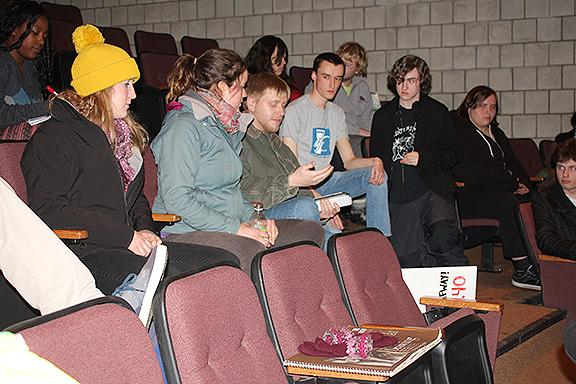 Student-trustee member Colin Santee shows a crowd of Johnson State College students  financial data on Vermont State Colleges Feb. 19.