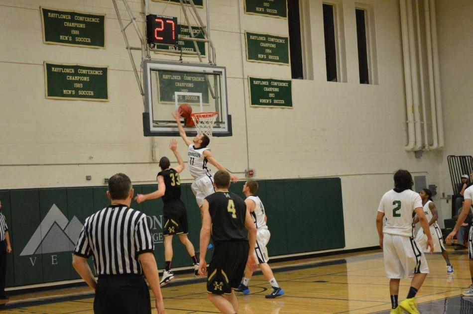 Bryan Hickey blocks Dan Fleming in game against Husson