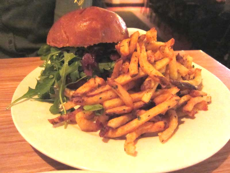 The+Mule%27s+%E2%80%9CWorks+for+Me%2C%E2%80%9D+a+burger+topped+with+pickled+onions%2C+arugula%2C+and+aioli+priced+at+%2418.