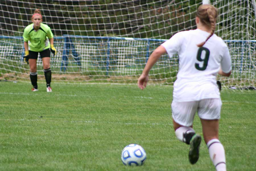 Kylie Aither goes for a goal
