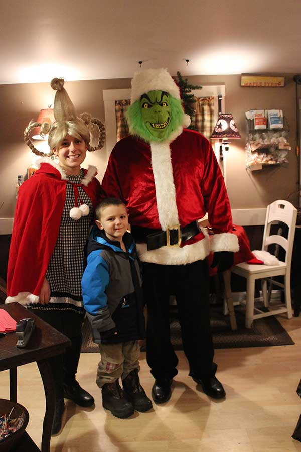 The Grinch and Cindy Lou Who greeted people at Maple Addictions