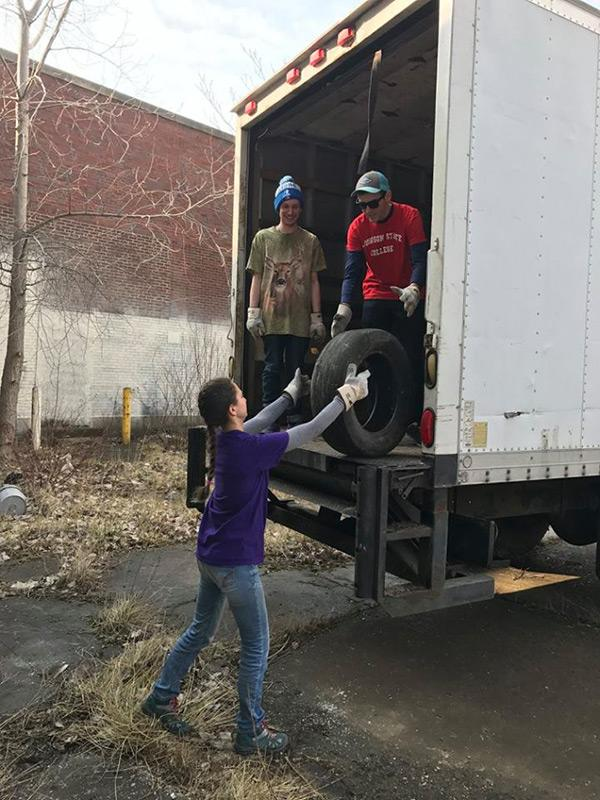 Zac Whitcomb, Seth Irwin and Sasha Yazdzik transport tires to be recycled