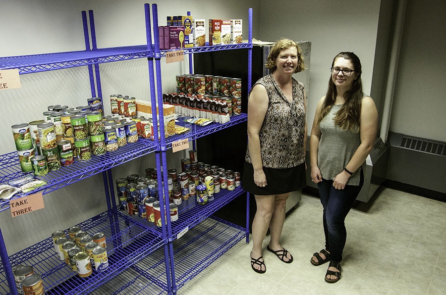Krista+Swahn+and+Shavonna+Bent+in+the+food+pantry