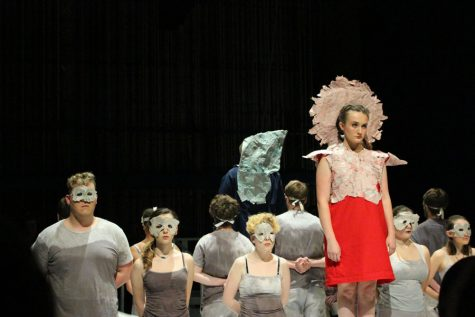 Katelyn Shaw as Antigone, with ensemble behind