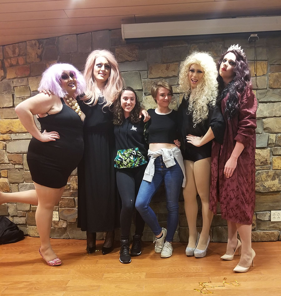 Adriana and Marisa Eldred pose with drag queens