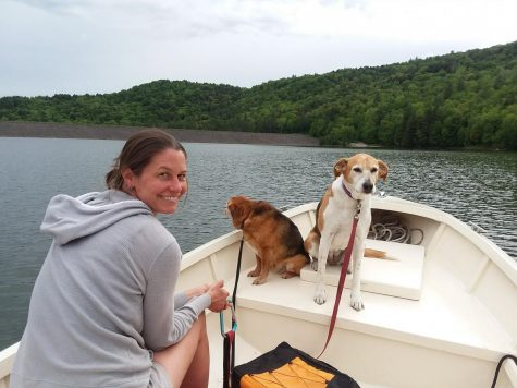 Emily Tarleton enjoying some time out boating with her doggos.