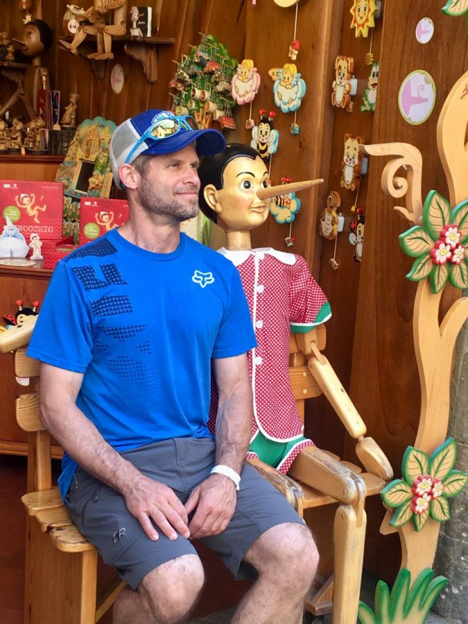 Brad Moskowitz sits with a wooden puppet on one of his many adventures