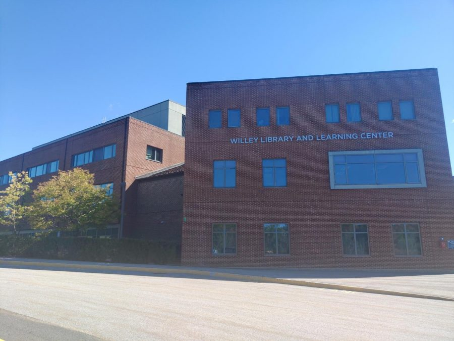 The windows of the Willey Library building near the Bentley parking lot